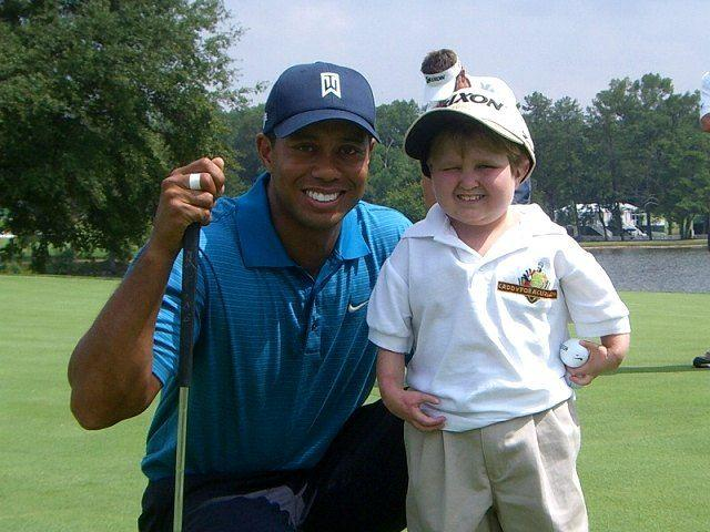 Tiger Woods w Christian Collins A
